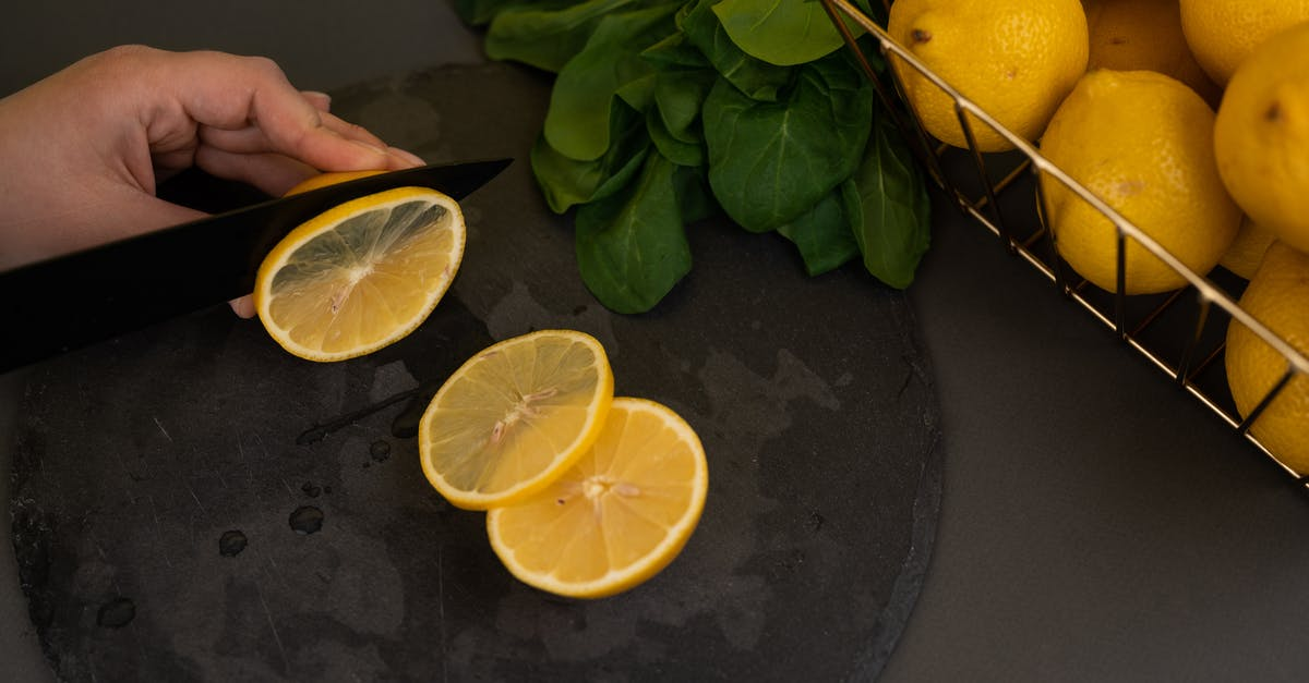 A banana and oranges on a table
