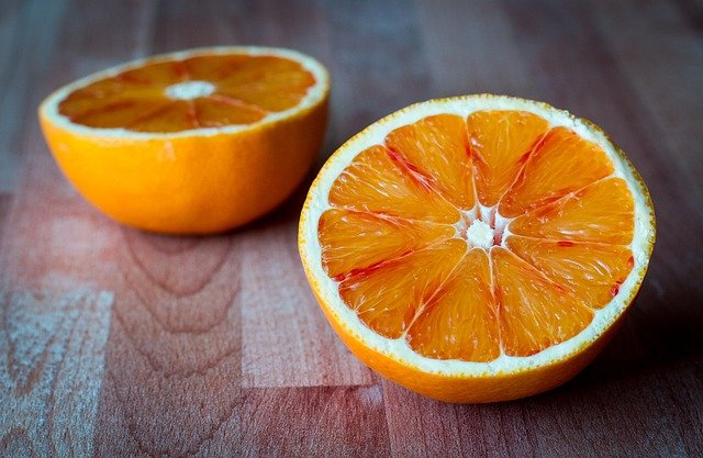 A close up of a sliced orange on a table